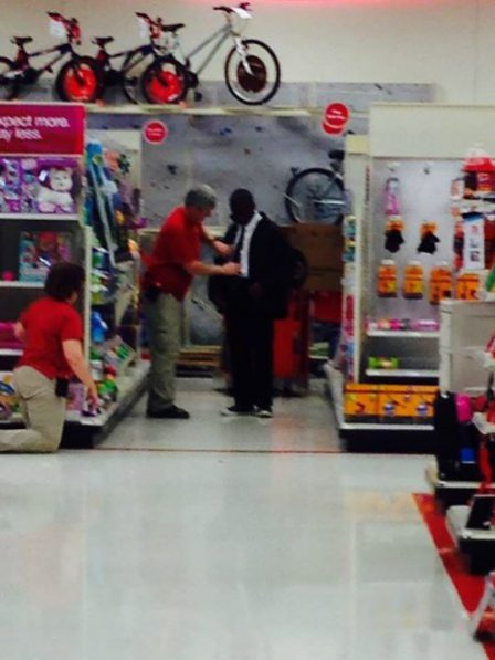 Target's excellent customer service example: Man helping teen tie his first tie.